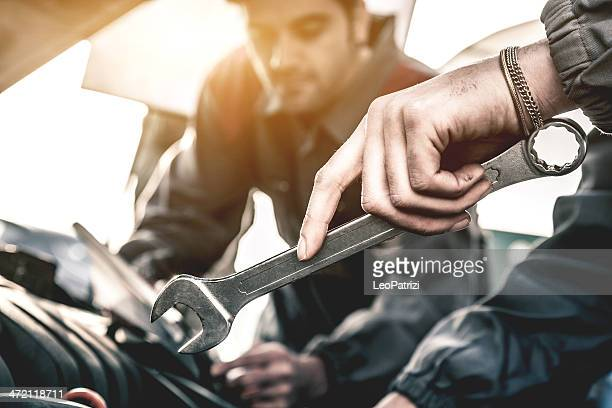 Auto mechanic fixing a car engine