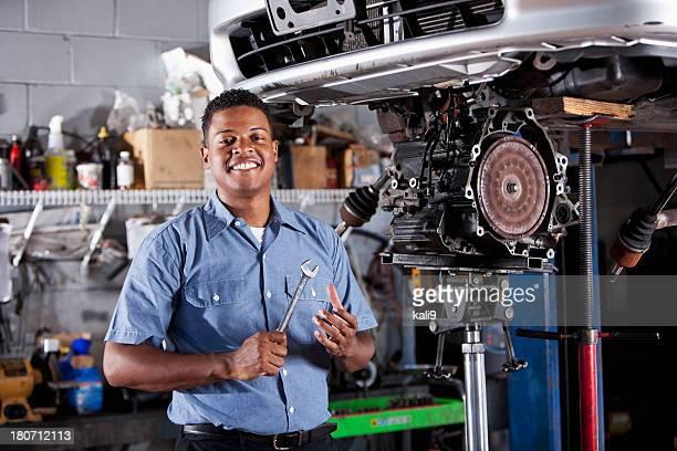 Auto mechanic fixing car transmission