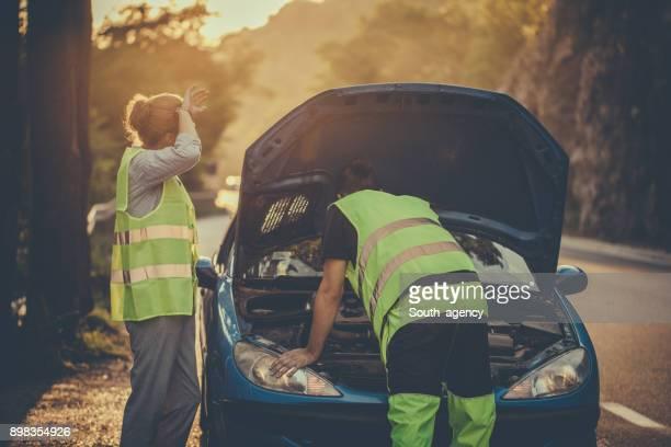 Auto mechanic helping a girl