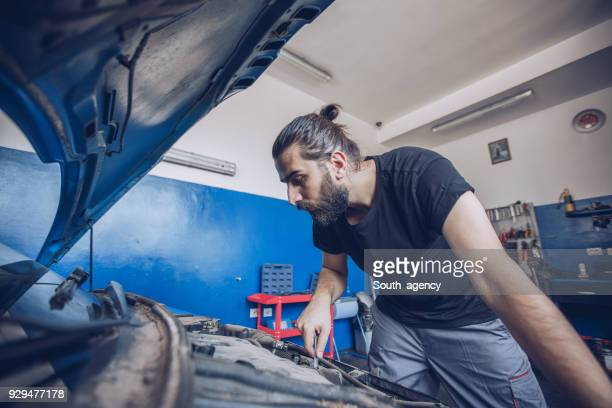auto mechanic in garage - electric motor stock photos and pictures