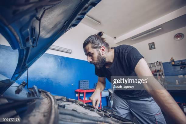 Auto mechanic in garage
