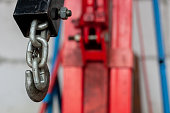auto mechanic lifting machine. transport service equipment. hook on strong chain.