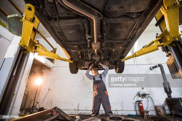 auto mechanic on the job - chassis stock pictures, royalty-free photos & images