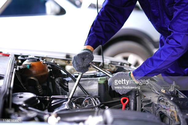 auto mechanic using repair tools check car in garage - engine stock pictures, royalty-free photos & images