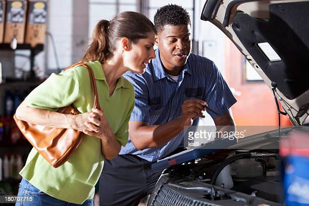 auto mechanic with customer - auto repair shop stock pictures, royalty-free photos & images