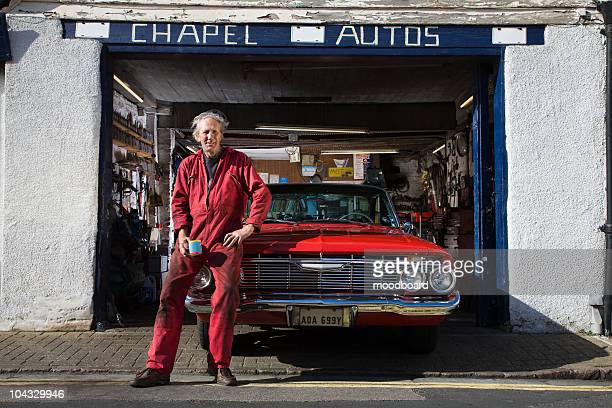 auto mechanic with restored 1961 chevrolet impala - mechanic stock pictures, royalty-free photos & images