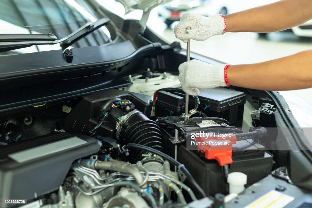 Auto mechanic working in garage, Car Repair Service center. : Stock Photo