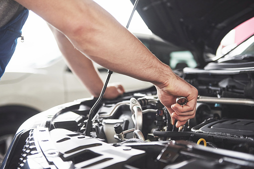 Auto mechanic working in garage. Repair service 879696186