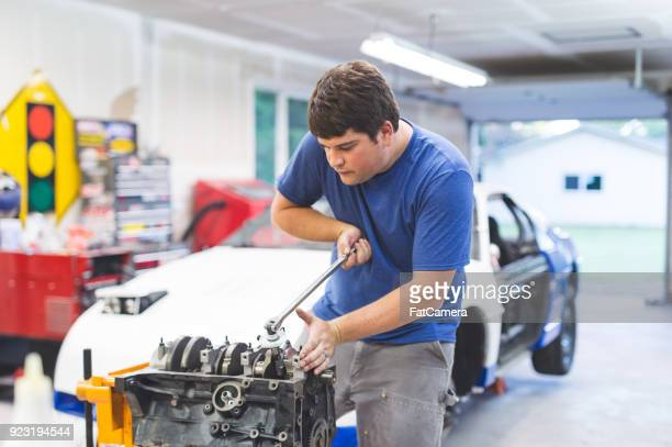 auto mechanic working on race car in home garage - rally car stock photos and pictures