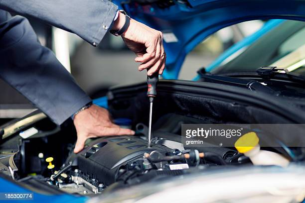 Auto mechanic working on the engine