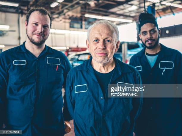 auto mechanics group portriat - labor union stock pictures, royalty-free photos & images