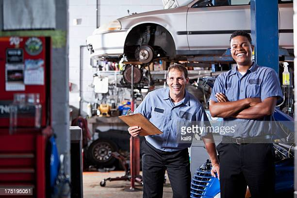 auto mechanics in garage - car mechanic stock pictures, royalty-free photos & images
