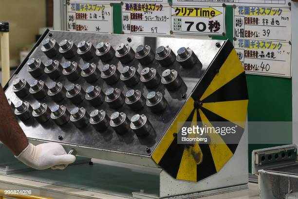 Auto parts sit in a die casting area at the Jtekt Corp Hanazono plant in Okazaki Aichi Prefecture Japan on Tuesday July 10 2018 JTEKT will make an...