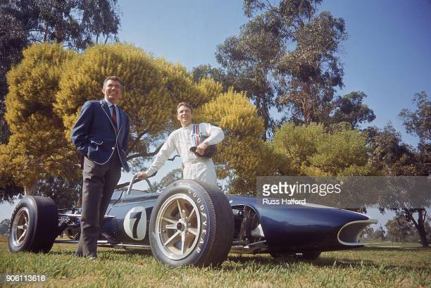 Portrait of automotive designer and former racer Carroll Shelby and driver Dan Gurney posing with American Eagle car Los Angeles CA CREDIT Russ...