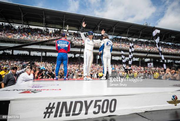 101st Indianapolis 500 Takuma Sato Fernando Alonso and JR Hildebrand wave to the crowd before race at Indianapolis Motor Speedway Verizon IndyCar...