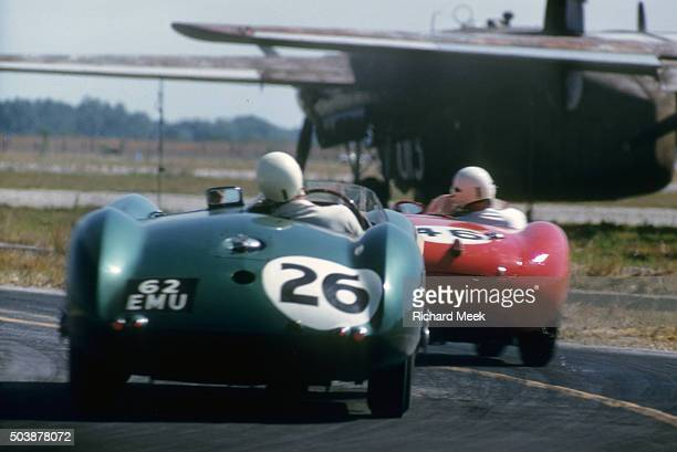 12 Hours of Sebring Stirling Moss in action driving Aston Martin vs Maserati 150S driven by Bill Lloyd or Karl Brocken at Sebring International...
