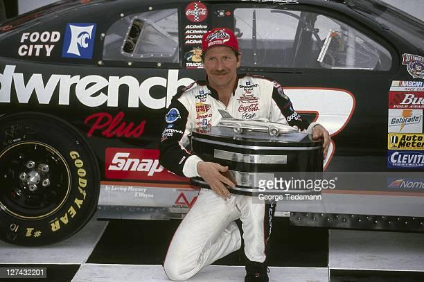40th NASCAR Daytona 500 Closeup of Dale Earnhardt victorious with trophy in victory lane after winning race at Daytona International Speedway Daytona...