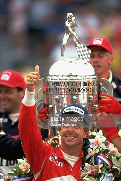 Auto Racing CART Indianapolis 500 Closeup of Rick Mears victorious with BorgWarner Trophy and flowers after winning race Indianapolis IN 5/26/1991