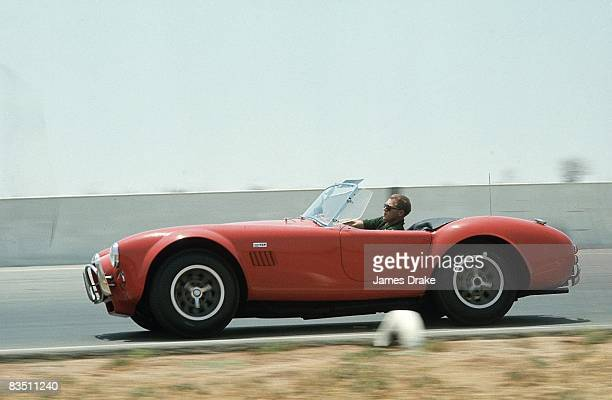 Celebrity actor Steve McQueen in action driving car Riverside CA 6/13/1966 CREDIT James Drake