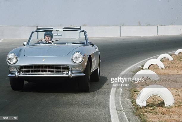 Celebrity actor Steve McQueen in action driving car Riverside CA 6/13/1966 CREDIT James Drake