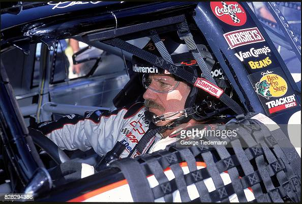closeup of dale earnhardt sitting in car before race at