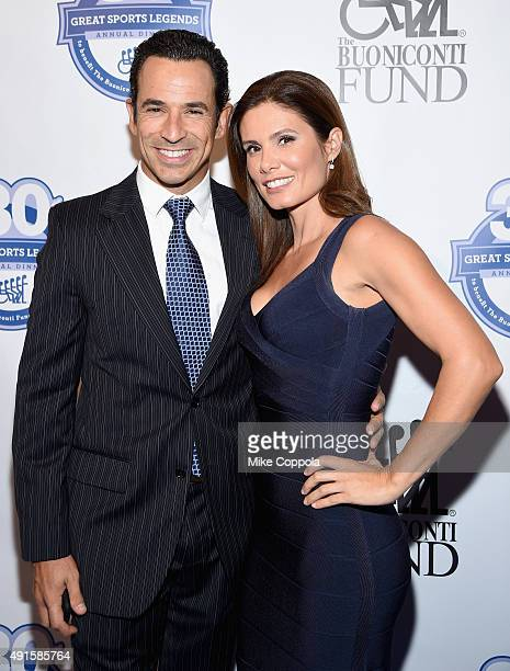 Auto Racing Driver Helio Castroneves and his wife Adriana Henao attend the 30th Annual Great Sports Legends Dinner to benefit The Buoniconti Fund to...