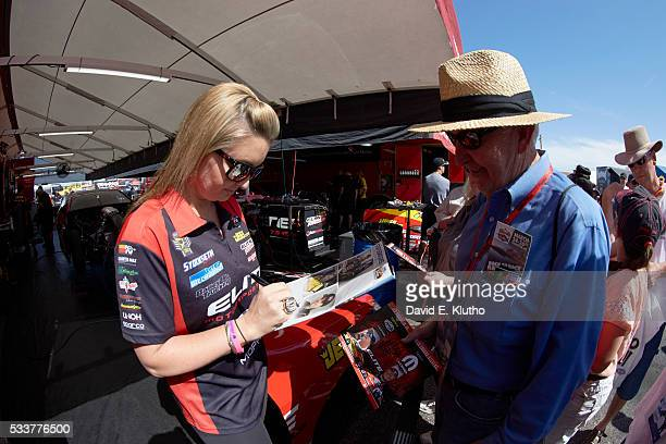 Erica Enders signing autographs for fan during photo shoot at Wild Horse Pass Motorsports Park In 2014 Enders became the first woman to win the NHRA...