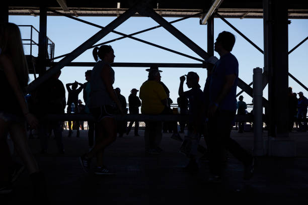 silhouette view of fans walking the concourse during race at