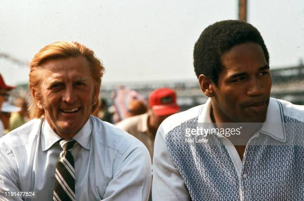 Indianapolis 500 View of actor Kirk Douglas and Buffalo Bills draft pick and running back OJ Simpson in car before race at Indianapolis Motor...