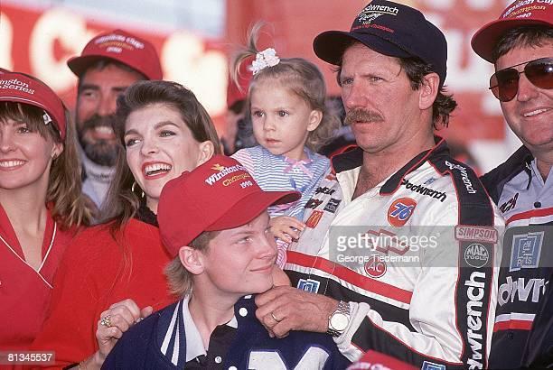 Auto Racing NASCAR Atlanta Journal 500 Closeup of Dale Earnhardt Sr with son Dale Earnhardt Jr Hampton GA