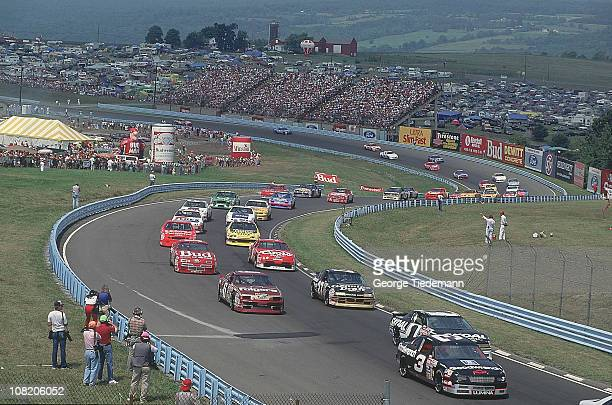 NASCAR Budweiser at The Glen Dale Earnhardt Sr in action leading vs Mark Martin Terry Labonte and Rusty Wallace through Sturn during race at Watkins...