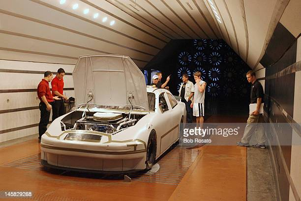 NASCAR Casual portrait of rookie Carl Edwards with his father Mike Edwards and his team during wind tunnel testing at Rousch Racing headquarters...