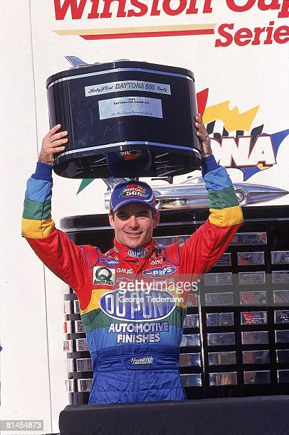 Auto Racing: NASCAR Daytona 500, Closeup of Jeff Gordon victorious with trophy after winning race, Daytona, FL 2/14/1999