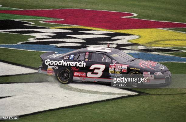 Auto Racing NASCAR Daytona 500 Dale Earnhardt victorious burnout donuts on infield after winning race Daytona FL 2/15/1998