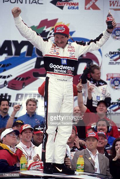 NASCAR Daytona 500 Dale Earnhardt victorious with arms raised hold Coke bottle on top of car after winning race at Daytona International Speedway...