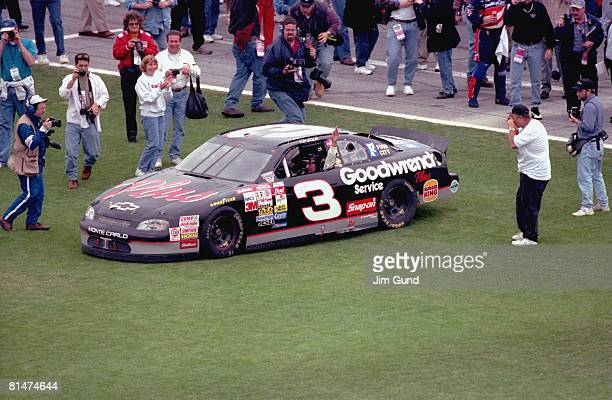Auto Racing NASCAR Daytona 500 Dale Earnhardt victorious with crew after winning race Daytona FL 2/15/1998