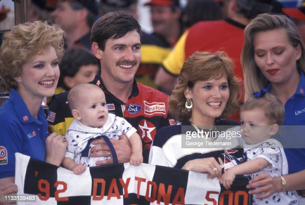 NASCAR Daytona 500 Davey Allison victorious with his wife Liz and their two children Robert and Krista after winning race at Daytona International...