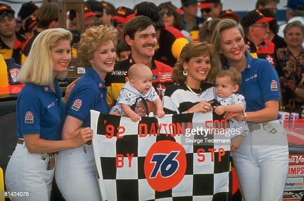 Auto Racing NASCAR Daytona 500 Davey Allison victorious with wife and children after winning race Daytona FL 2/16/1992