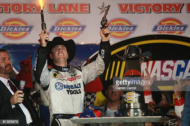 Auto Racing NASCAR Dickies 500 Jimmie Johnson victorious with pistols cowboy hat and trophy during victory lane celebration after winning race at...