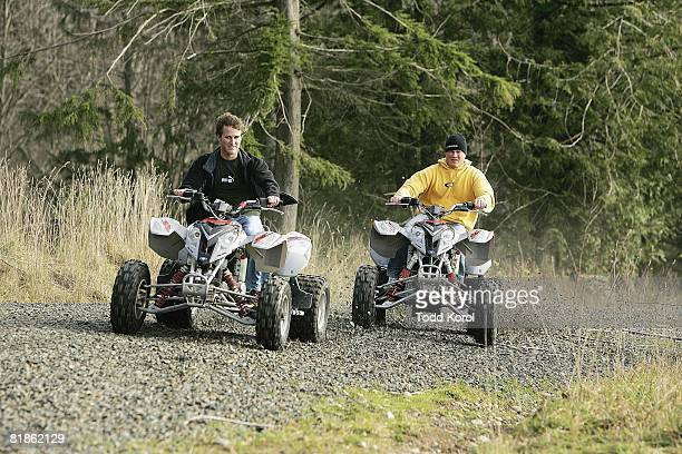 Auto Racing NASCAR driver Kasey Kahne with brother Kale on All Terrain Vehicles ATV Enumclaw WA