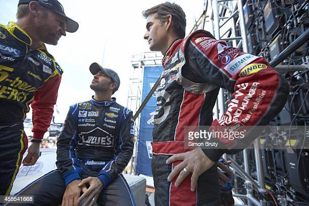 NASCAR Federated Auto Parts 400 Jeff Gordon talks with Jimmie Johnson and Clint Bowyer before race at Richmond International Raceway Behind the...