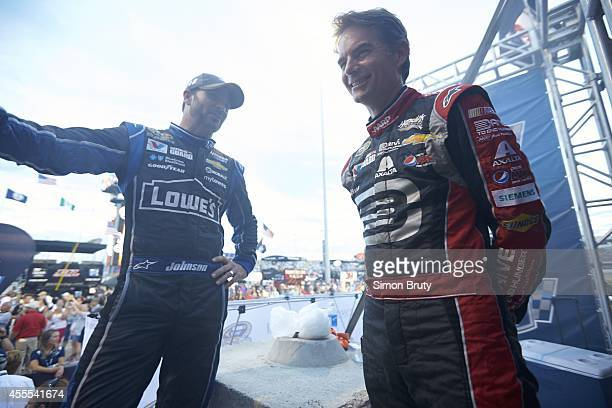 NASCAR Federated Auto Parts 400 Jeff Gordon talks with Jimmie Johnson before race at Richmond International Raceway Behind the Scenes Richmond VA...