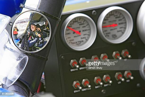 Auto Racing NASCAR Food City 500 Reflection of Kyle Busch in sideview mirror before race at Bristol Motor Speedway View of dashboard equipment...