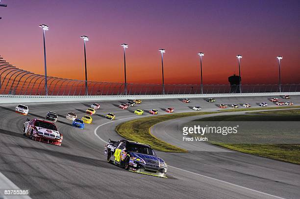 NASCAR Ford 400 Jimmie Johnson in action out of turn four during race at Miami Speedway Sprint Cup Championship Scenic view of sunset Homestead FL...