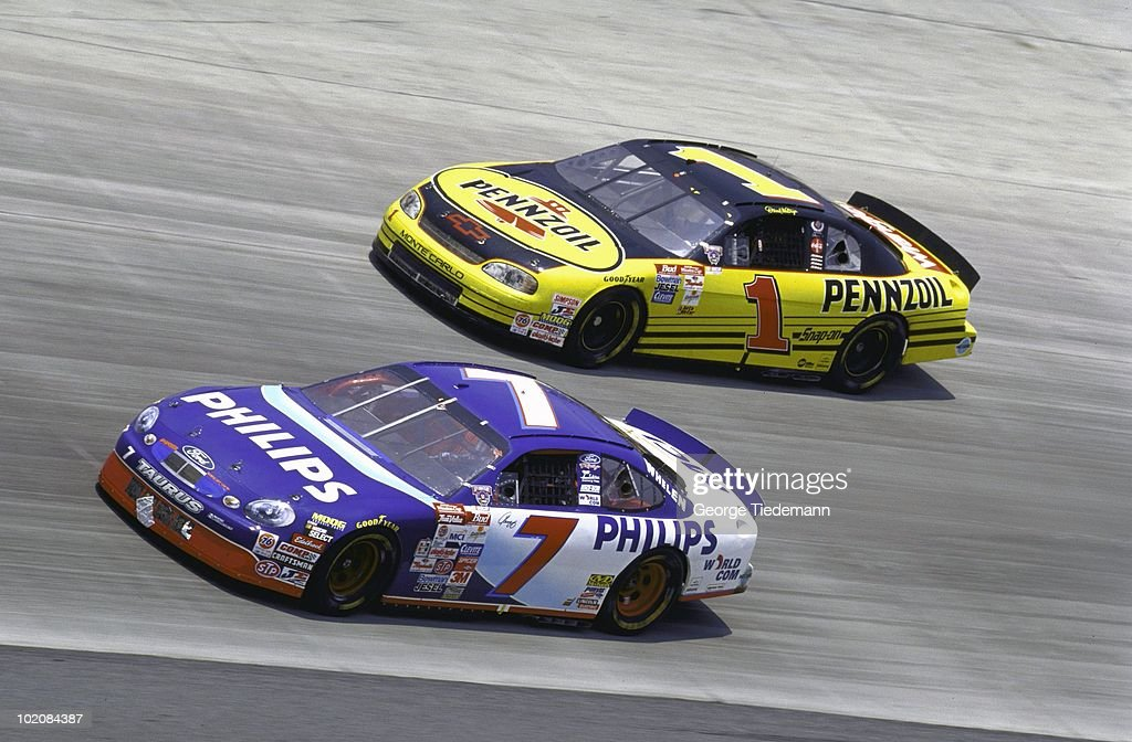 Geoff Bodine in action vs Darrell Waltrip during race at