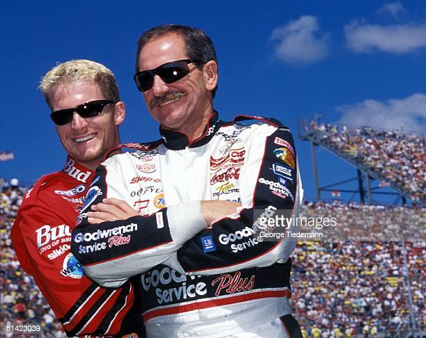 Auto Racing NASCAR Pepsi 400 Closeup portrait of Dale Earnhardt Jr and his father Dale Earnhardt Sr before race at Michigan Speedway Brooklyn MI...