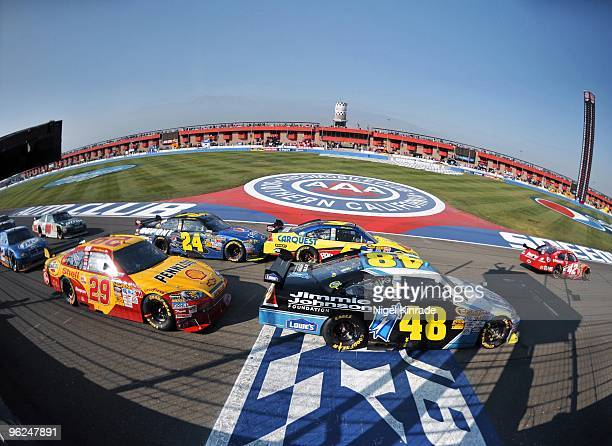 NASCAR Pepsi 500 Juan Pablo Montoya Mark Martin and Jimmie Johnson during restart at Auto Club Speedway Fontana CA CREDIT Nigel Kinrade