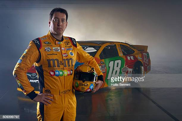 NASCAR Season Preview Portrait of Kyle Busch posing with No 18 MM's Toyota Camry during photo shoot at Charlotte Motor Speedway Charlotte NC CREDIT...