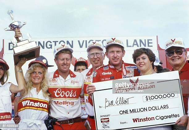 Auto Racing NASCAR Southern 500 Bill Elliott victorious with brother Dan wife Martha trophy and enlarged check after winning inaugural Winston...