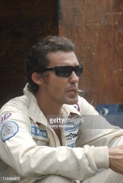 Portrait of Richard Petty smoking cigarette before race at ...